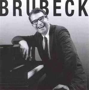 Dave Brubeck smiling on his piano